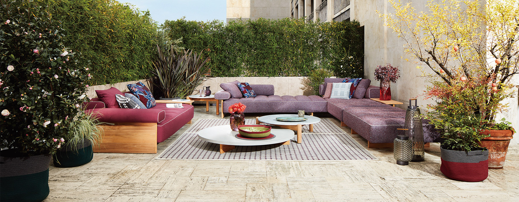 photo credits : DePasquale + Maffini, Sail Out sofa, low table and ottoman designed by Rodolfo Dordoni, Table a Plateau Interchangeable Outdoor designed by Charlotte Perriand